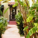 A mini oasis in the middle of a busy urban neighborhood greets both business customers as well as residents. The courtyard serves as the main entry walk, a secluded seating area, and a fountain grotto.